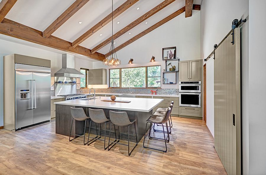 Modern farmhouse kitchen with sloped celing and wooden beams