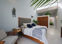 Modern-relaxing-bedroom-in-white-with-warm-wooden-elements-and-a-dash-of-color-217x155