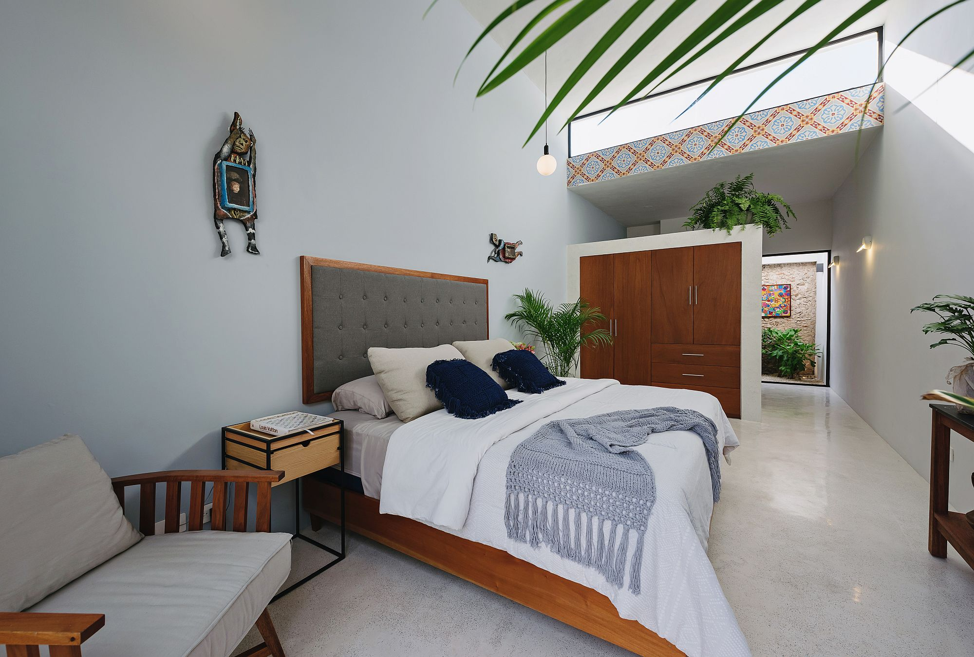 Modern-relaxing-bedroom-in-white-with-warm-wooden-elements-and-a-dash-of-color