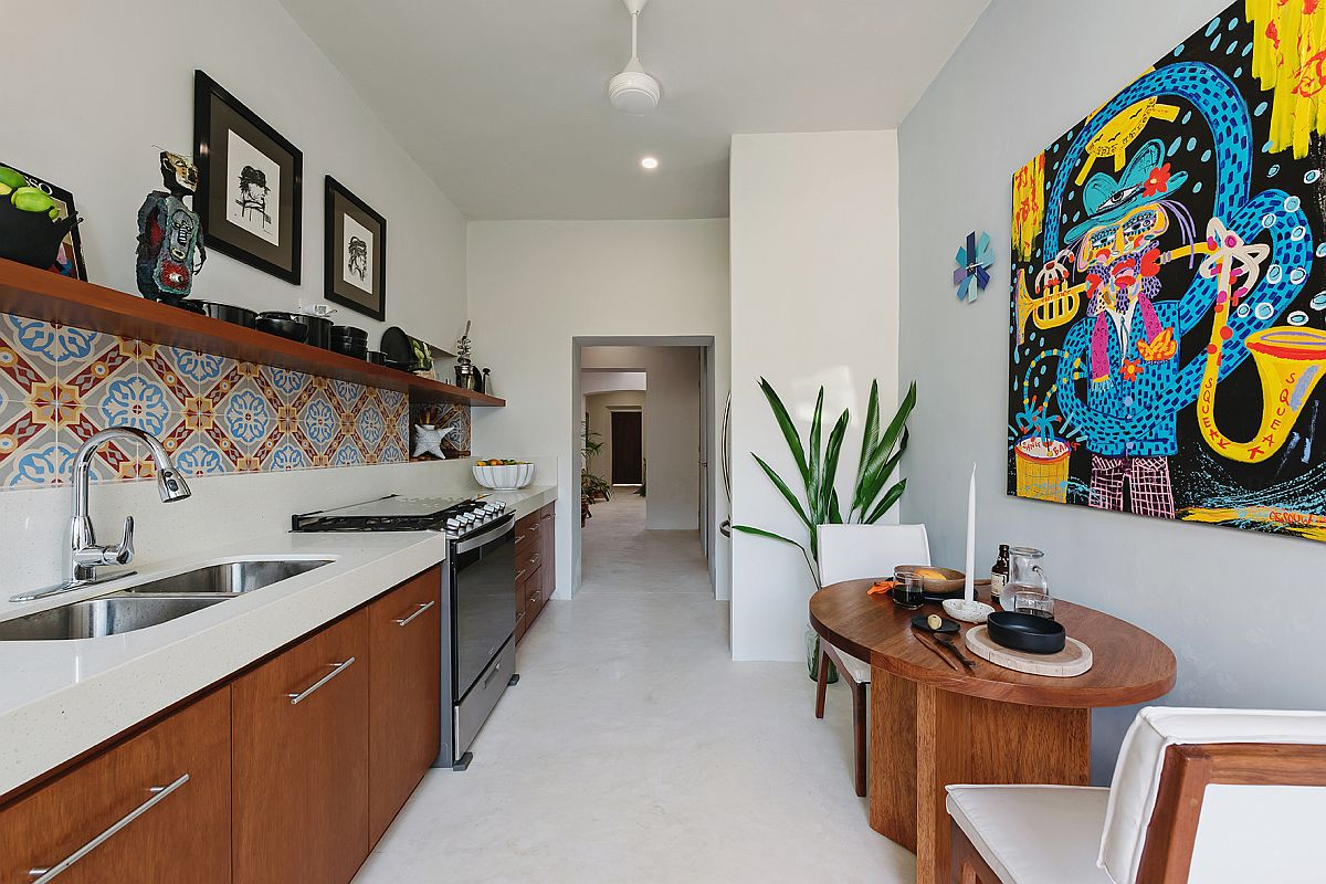 Narrow-kitchen-and-casual-breakfast-nook-in-white-and-wood-with-a-pinch-of-color