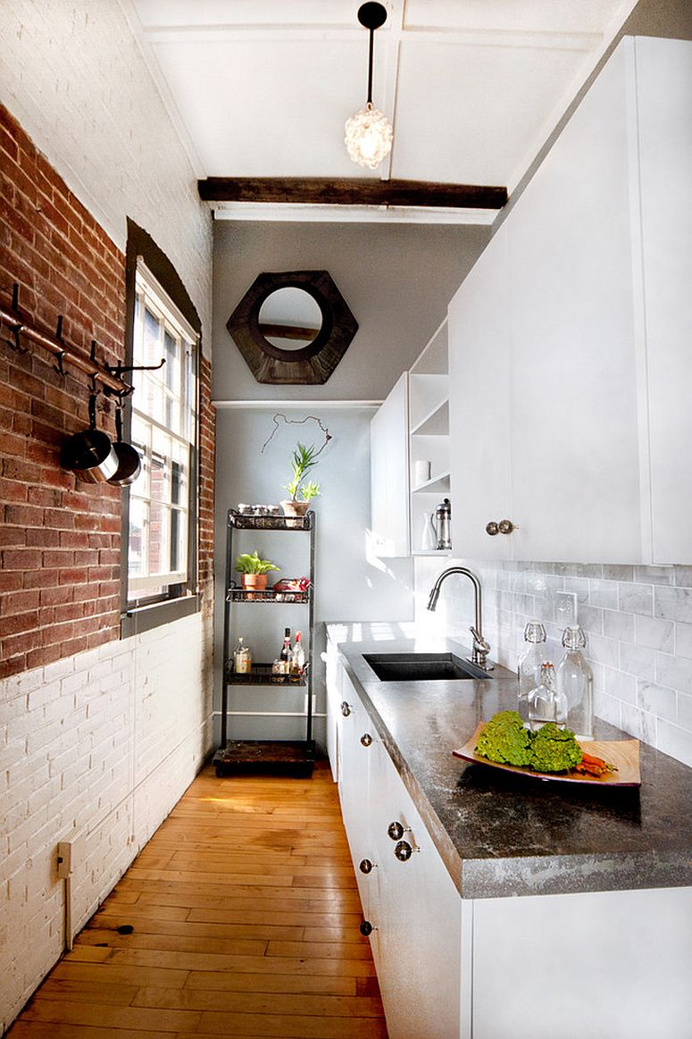 Narrow kitchen with whitewashed and exposed brick wall sections