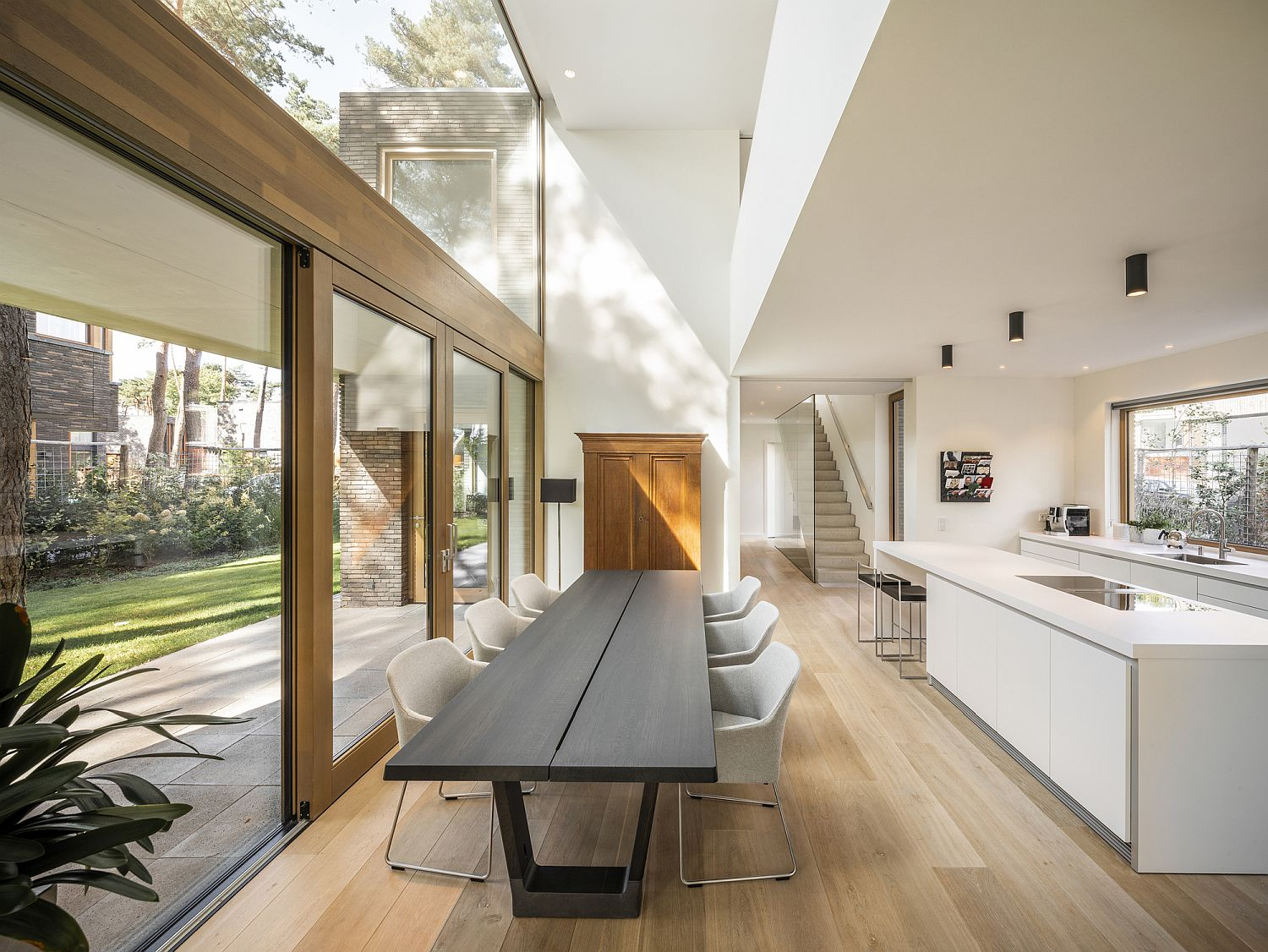 Open plan kitchen and dining with a skylight above that brings in ample ventilation