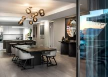 Open-plan-living-area-kitchen-and-dining-space-of-the-polished-apartment-in-Cape-Town-217x155