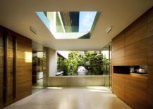 Opening-in-the-structure-of-the-house-brings-in-ample-natural-light-217x155