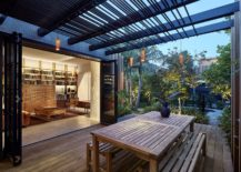 Pergola-structure-offers-shade-and-also-helps-illuminate-the-wooden-deck-217x155
