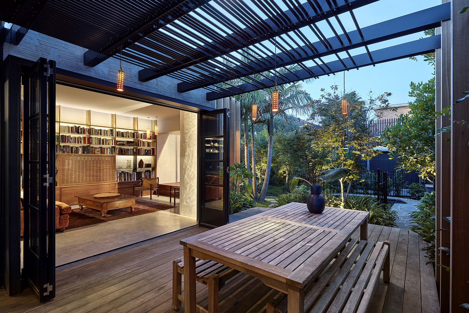 Pergola-structure-offers-shade-and-also-helps-illuminate-the-wooden-deck