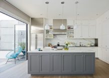 Polished-and-small-kitchen-in-white-with-a-lovely-gray-island-217x155