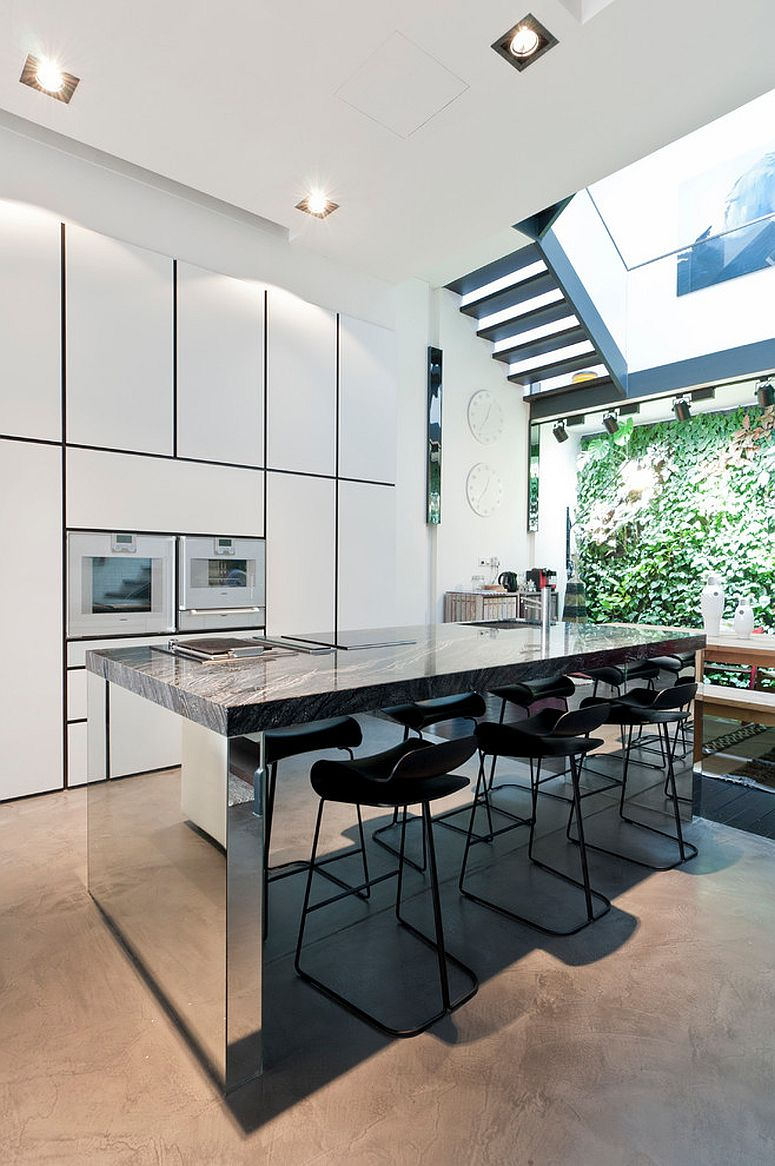 Reflective brilliance of the kitchen island steals the spotlight here