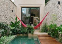 Relaxing-rear-wooden-deck-pool-area-and-hammock-at-Casa-Picasso-217x155