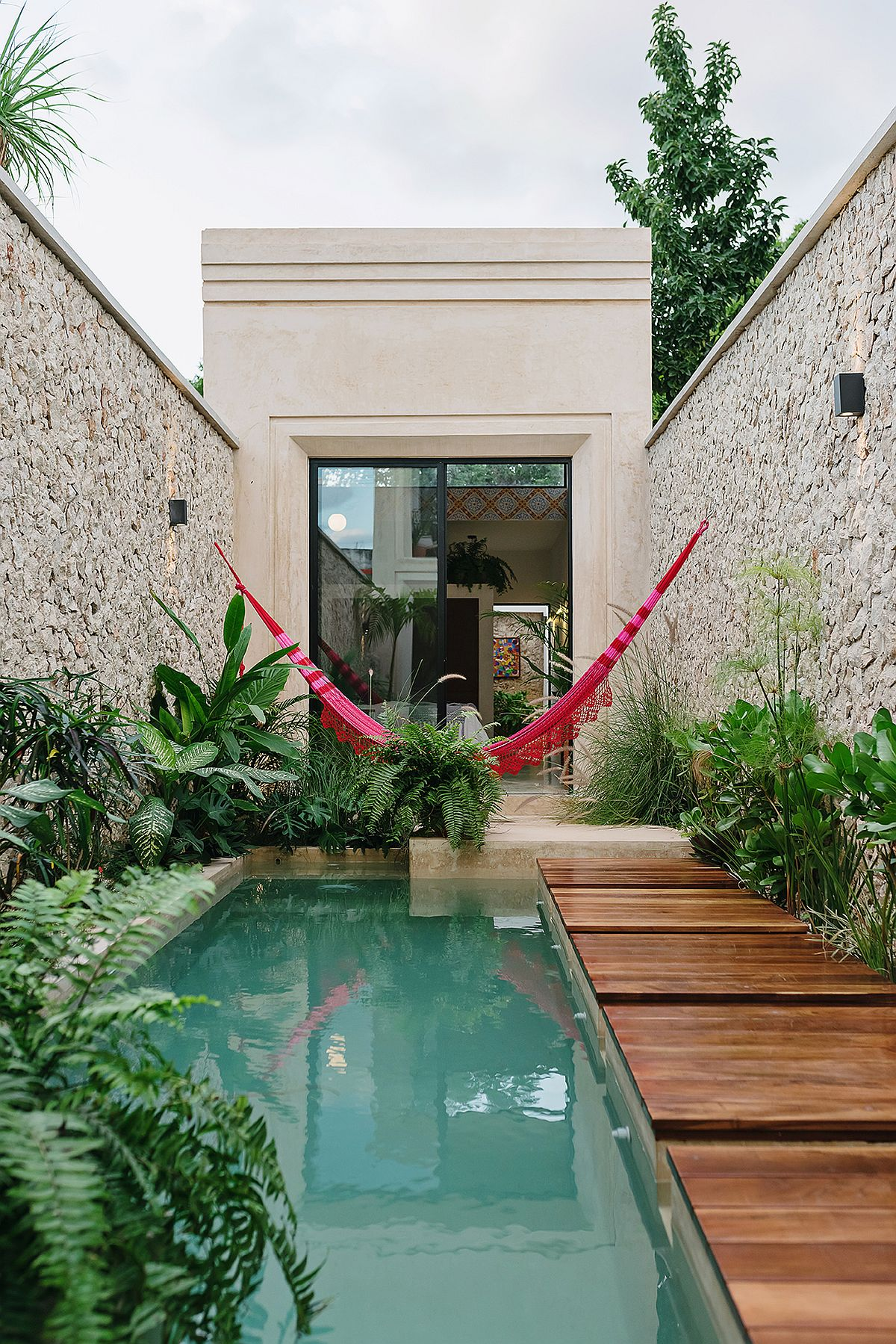 Relaxing-rear-wooden-deck-pool-area-and-hammock-at-Casa-Picasso