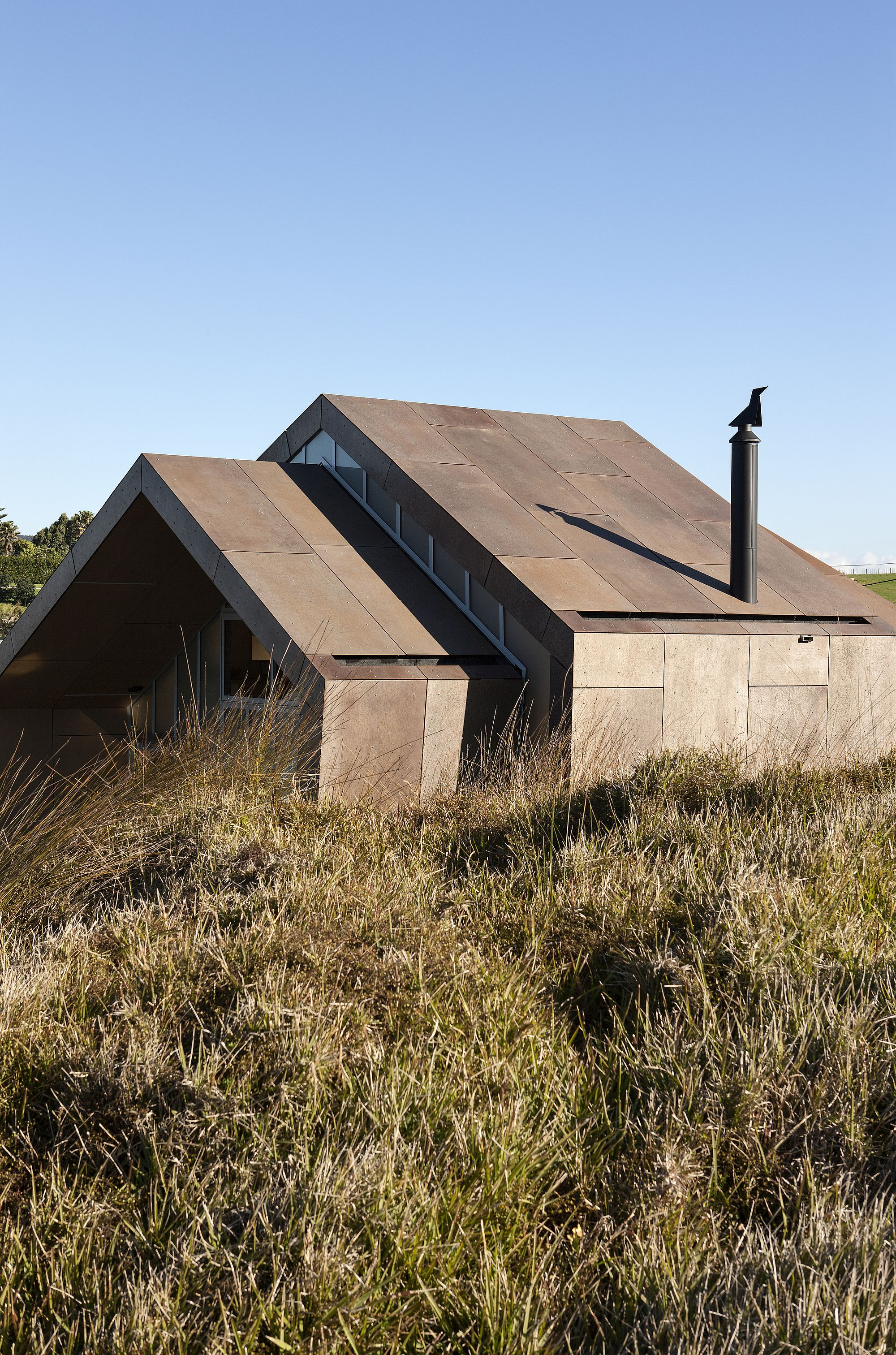 Rugged steel exterior of the seaside home