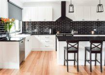 Shiny-black-tiled-backsplash-for-the-kitchen-in-white-217x155