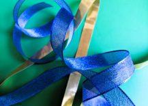 Shiny-blue-and-gold-ribbon-217x155