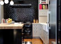 Shiny-shade-of-black-in-the-backdrop-brings-brightness-to-this-small-kitchen-217x155