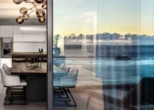 Sliding-glass-doors-delineate-the-dining-space-from-the-balcony-217x155