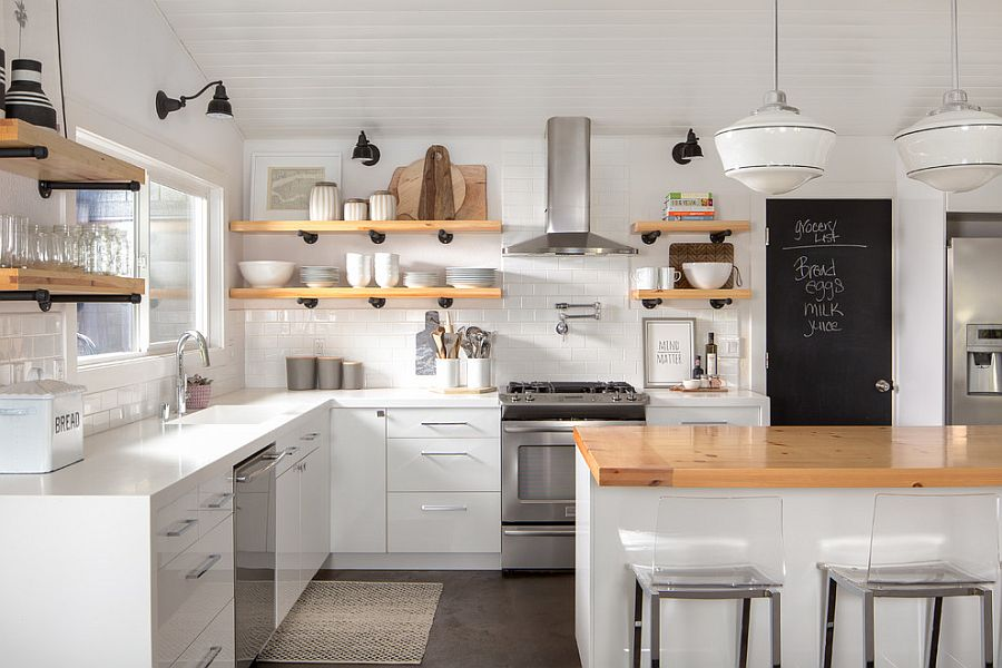 Slim wooden shelves make most of the limited space in the modest white kitchen