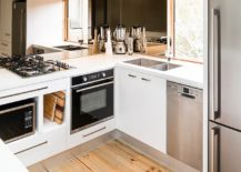 Small-modern-kitchen-of-Melbourne-home-with-a-mirrored-backsplash-217x155
