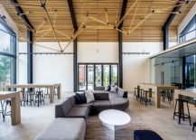 Spacious-double-height-interior-of-the-structure-inspired-by-local-design-217x155