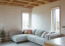 Spacious-living-room-with-a-sectional-that-perfectly-fits-into-the-corner-217x155