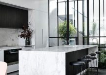 Spacious-modern-kitchen-in-black-and-white-with-marble-island-tops-217x155