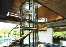 Spiral-staircase-connects-various-levels-of-the-house-even-as-the-pool-around-it-makes-a-statement-217x155
