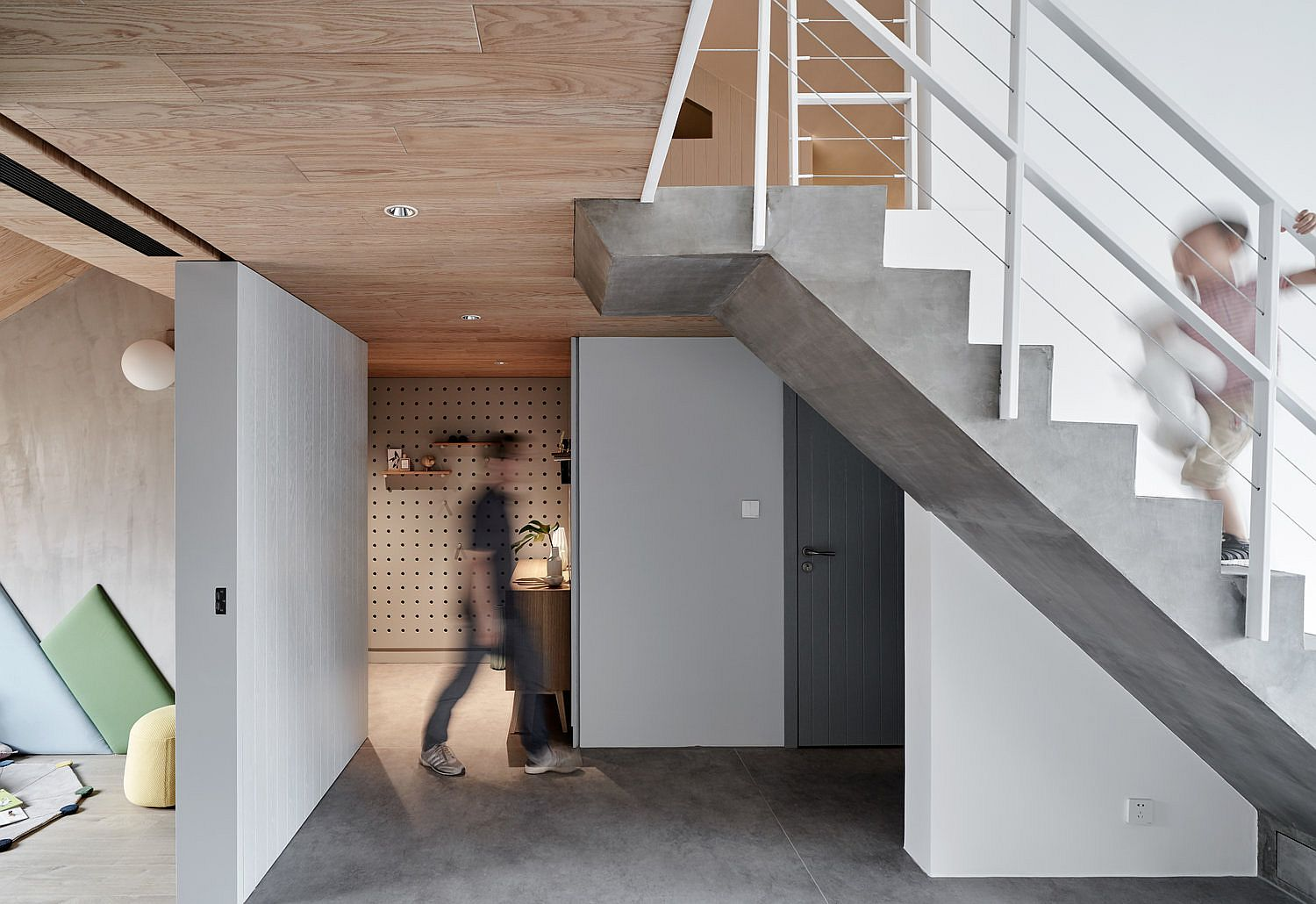 Staircase and floor brings concrete charm to the interior