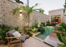 Stone-wall-lush-green-vegetation-and-a-slim-wooden-deck-create-a-private-and-relaxing-pool-zone-217x155