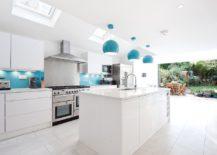 Stylish-and-urbane-kitchen-in-white-with-blue-backsplash-and-pendants-217x155