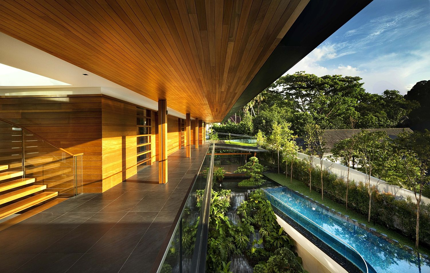 Sweeping decks and swimming pool overlook the botanical garden outside