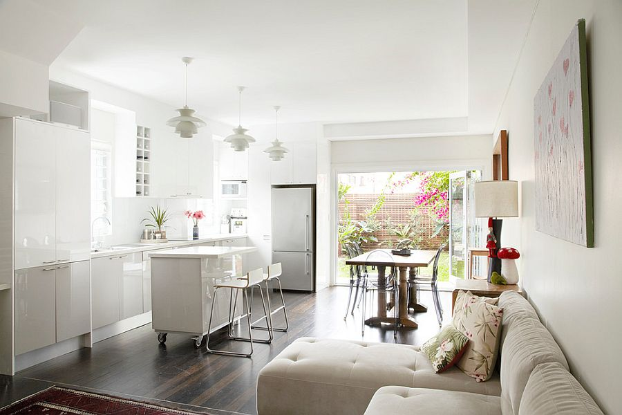 Tiny white kitchen island on wheels offers design flexibility along with contemporary style
