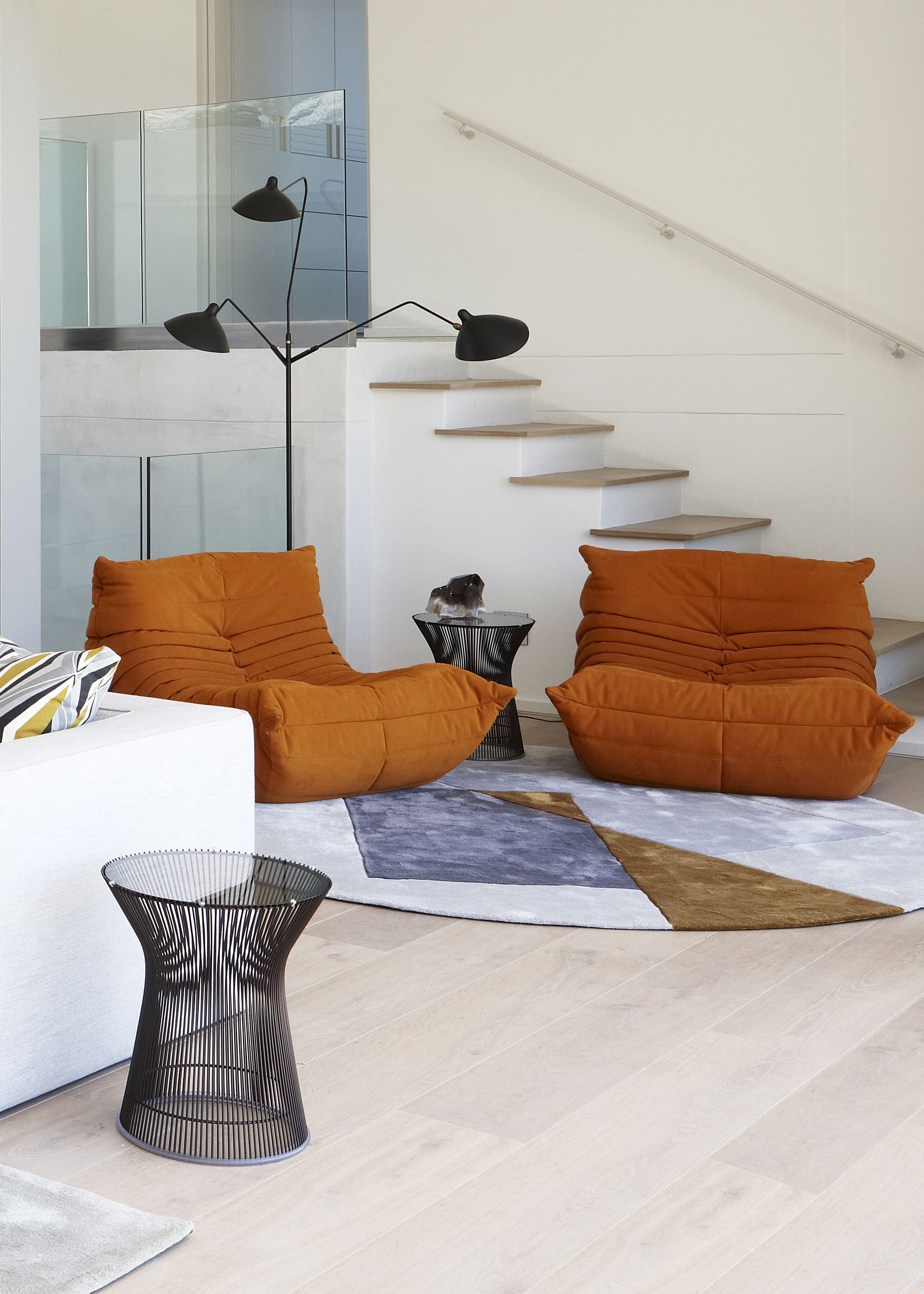 Togo Sofa in orange is a showstopper no matter where it sits
