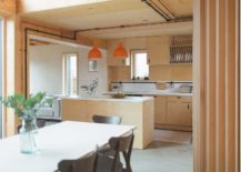 Twin-orange-pendants-add-color-to-the-neutral-kitchen-space-217x155