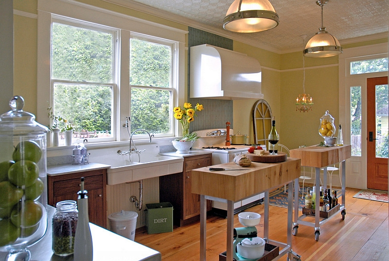 Two narrow, custom-built kitchen islands on wheels are perfect for the small kitchen