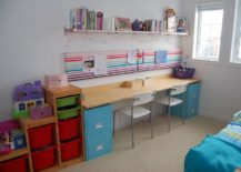 Using-a-couple-of-filing-cabinets-and-a-slim-wooden-plank-to-create-a-smart-crafting-table-217x155