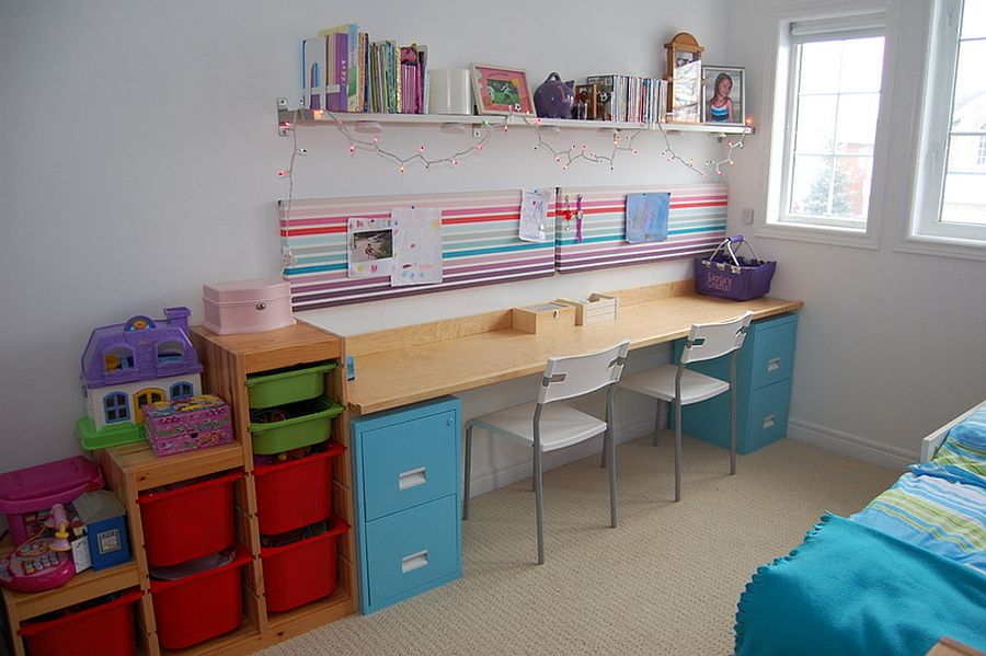 Using a couple of filing cabinets and a slim wooden plank to create a smart crafting table
