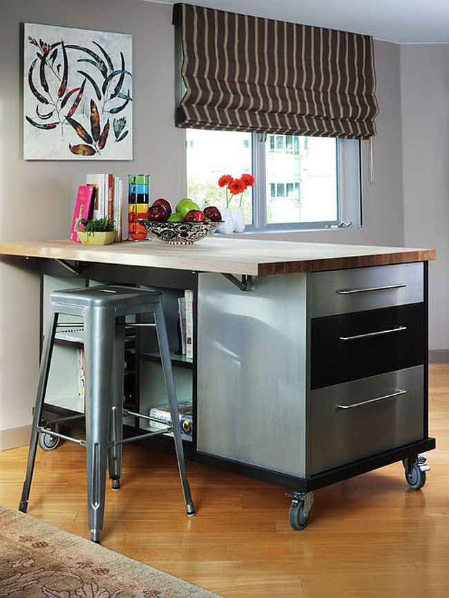 Versatile island on wheels brings counter and storage space to the small modern kitchen