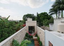 View-from-above-of-the-pool-area-and-the-narrow-house-217x155