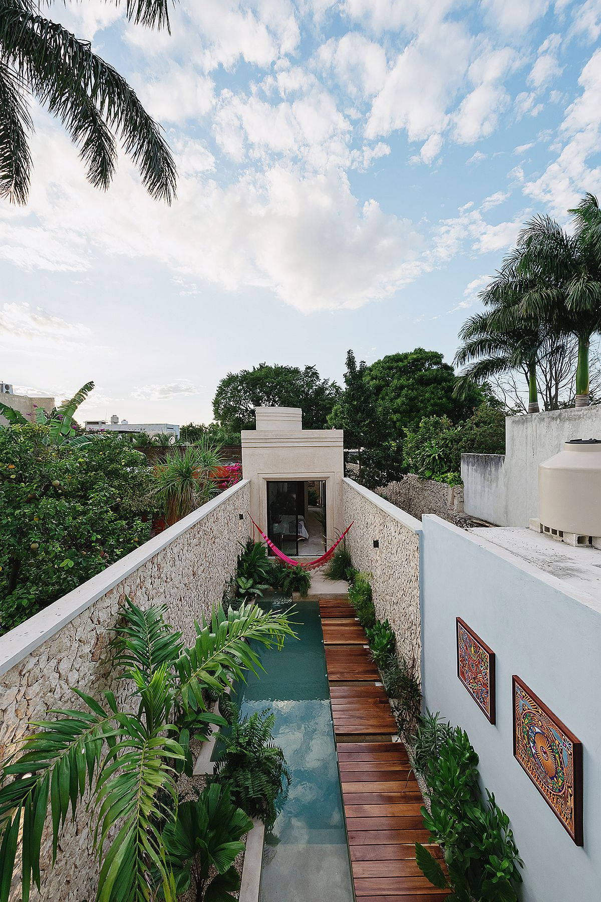View-from-above-of-the-pool-area-and-the-narrow-house