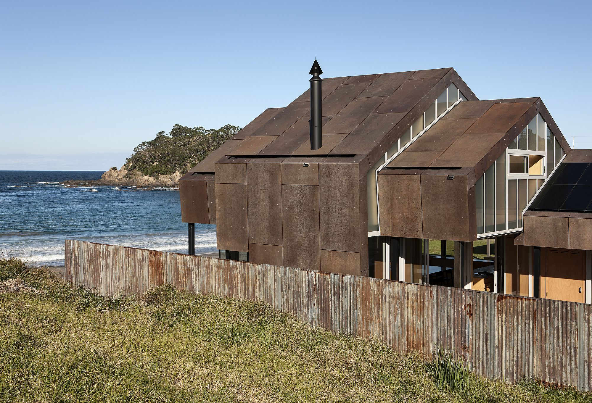 Weathered steel exterior of the oceanside home