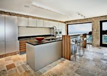 White-and-the-view-outside-bring-spaciousness-to-this-Mediterranean-style-kitchen-217x155
