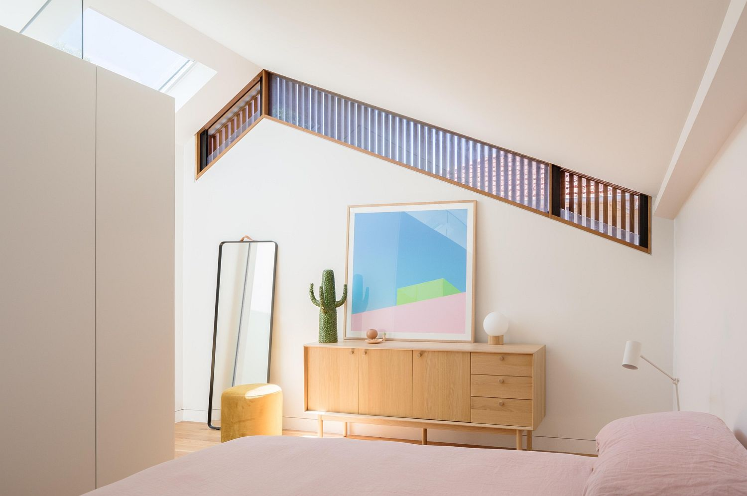 White attic level bedroom of the house with modern minimal style