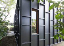 Window-adds-to-the-geometric-style-of-the-metallic-facade-217x155