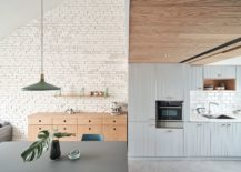 Wood-and-weathered-tiles-on-the-wall-add-warmth-to-the-apartment-interior-217x155