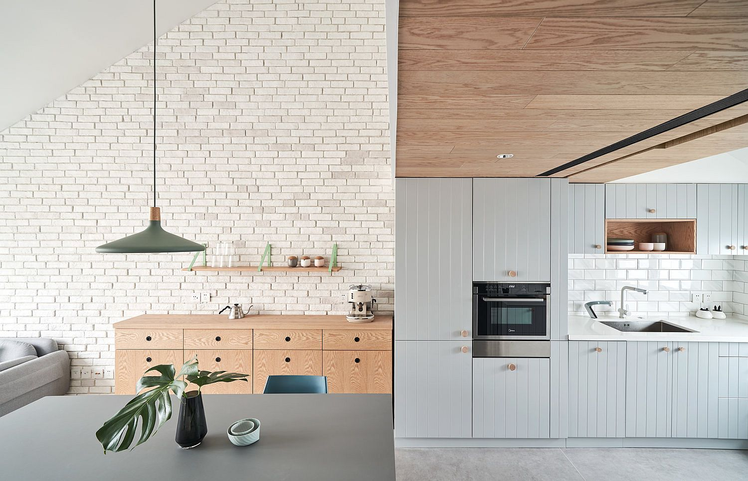 Wood-and-weathered-tiles-on-the-wall-add-warmth-to-the-apartment-interior