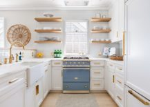 Wood-and-white-with-a-striking-addition-of-blue-in-the-space-savvy-kitchen-217x155