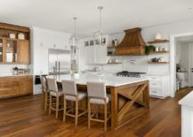 Wooden-cabinets-add-warmth-and-charm-to-the-kitchen-in-white-with-wooden-floor-217x155