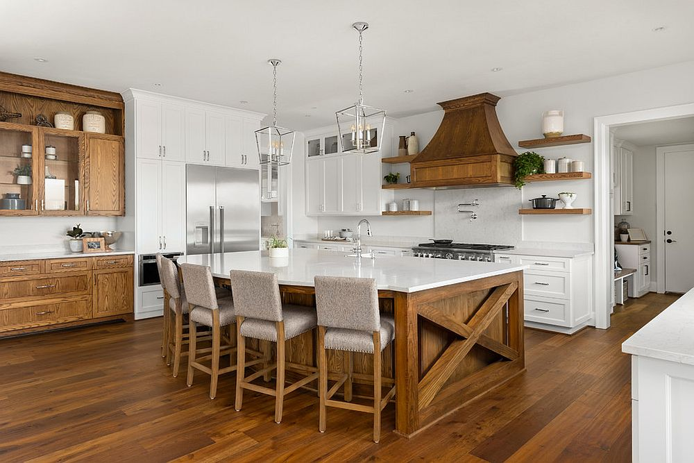 Wooden cabinets add warmth and charm to the kitchen in white with wooden floor