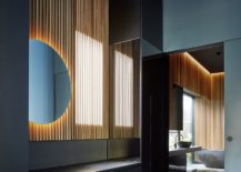 Wooden-slats-and-round-mirror-accentuated-by-brilliant-use-of-lighting-217x155