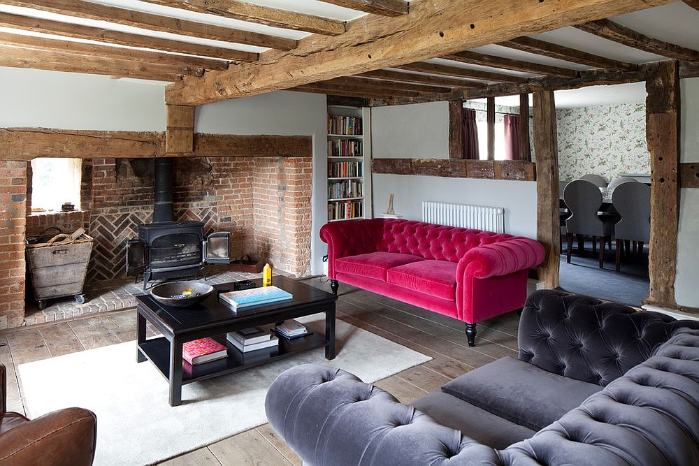 Accent couch in bright pink adds color to the cozy living room