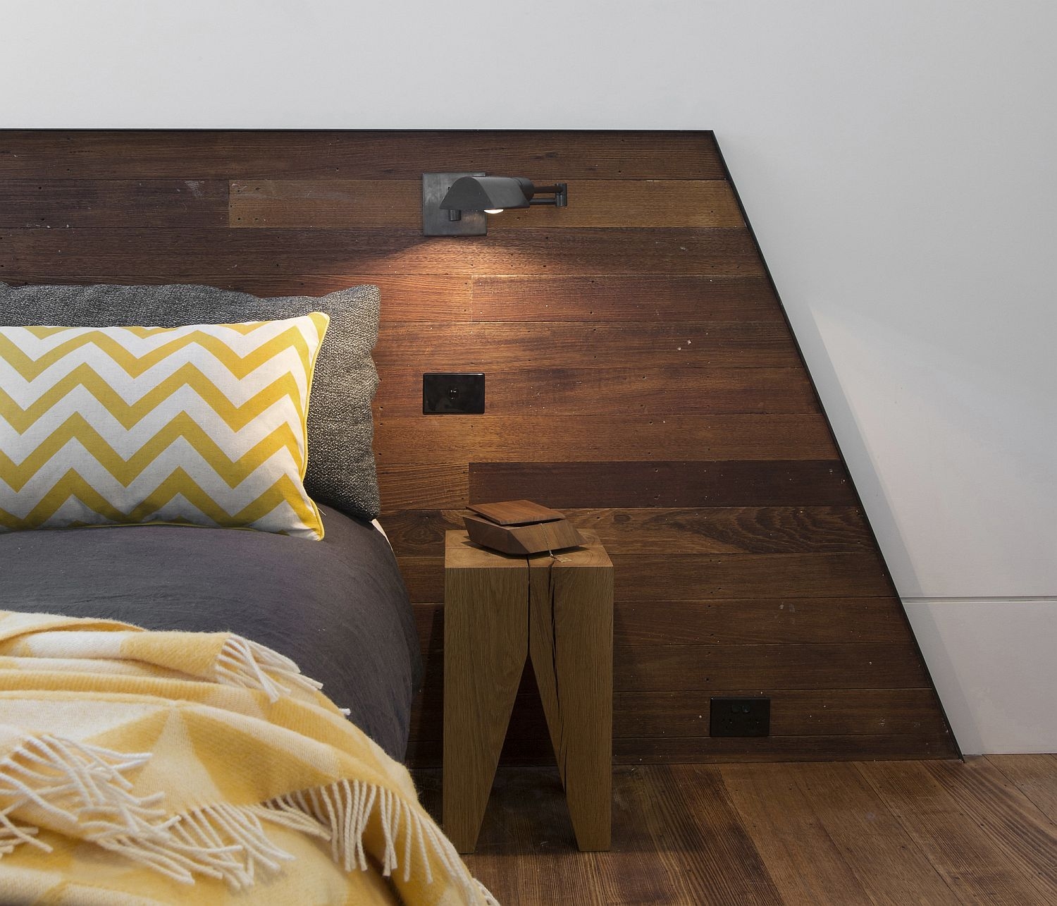 Accent pillow adds a bit of yellow and chevron pattern to the bedroom